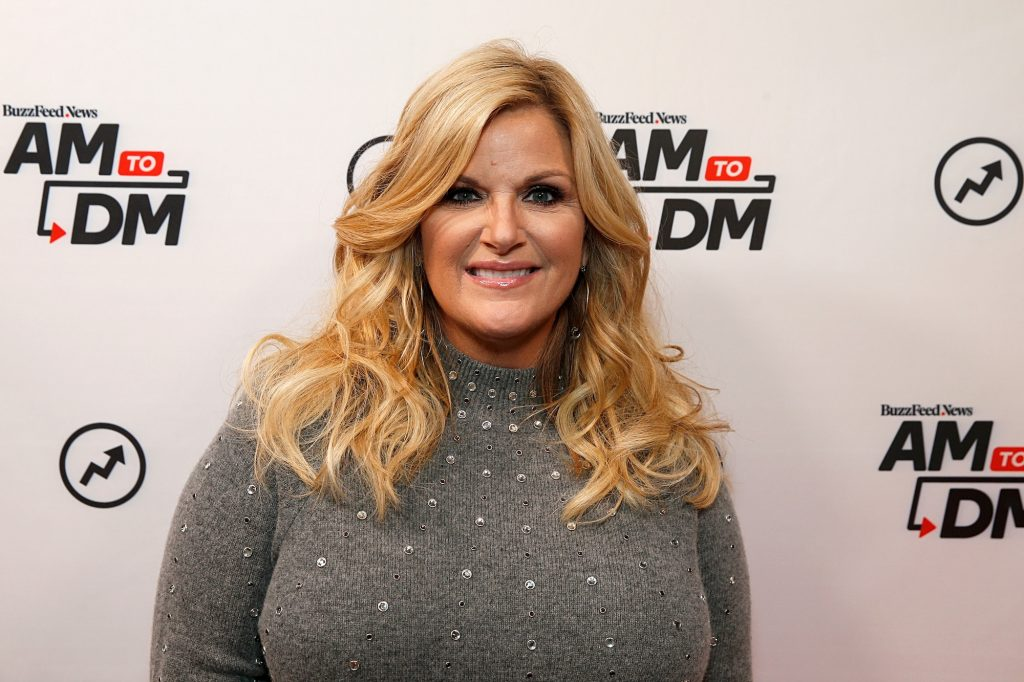 Trisha Yearwood smiling in front of a white background