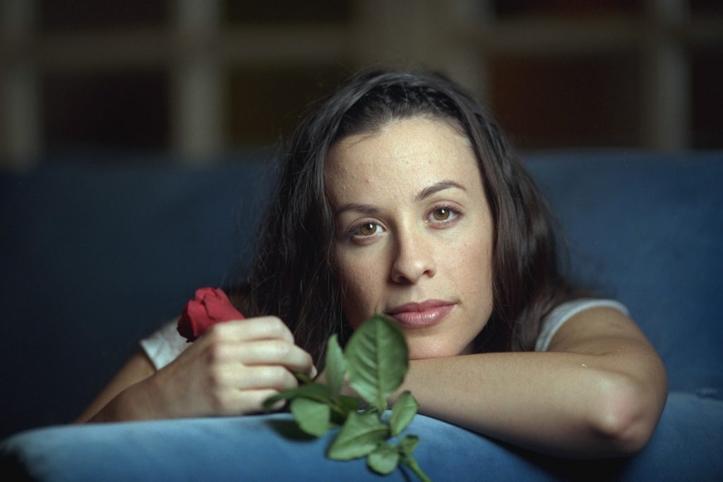 Alanis Morissette with a rose