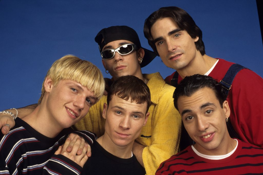 The Backstreet Boys in front of a blue background