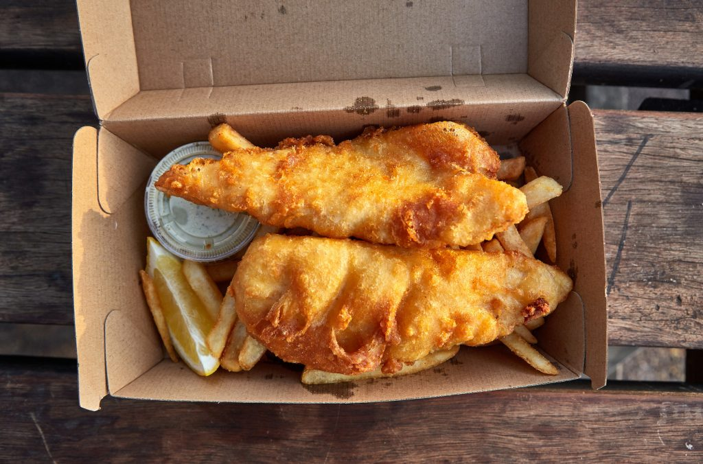 Fish and chips in a cardboard box.