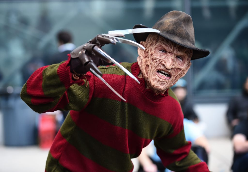 A cosplayer dressed as Freddy Krueger from A Nightmare on Elm Street