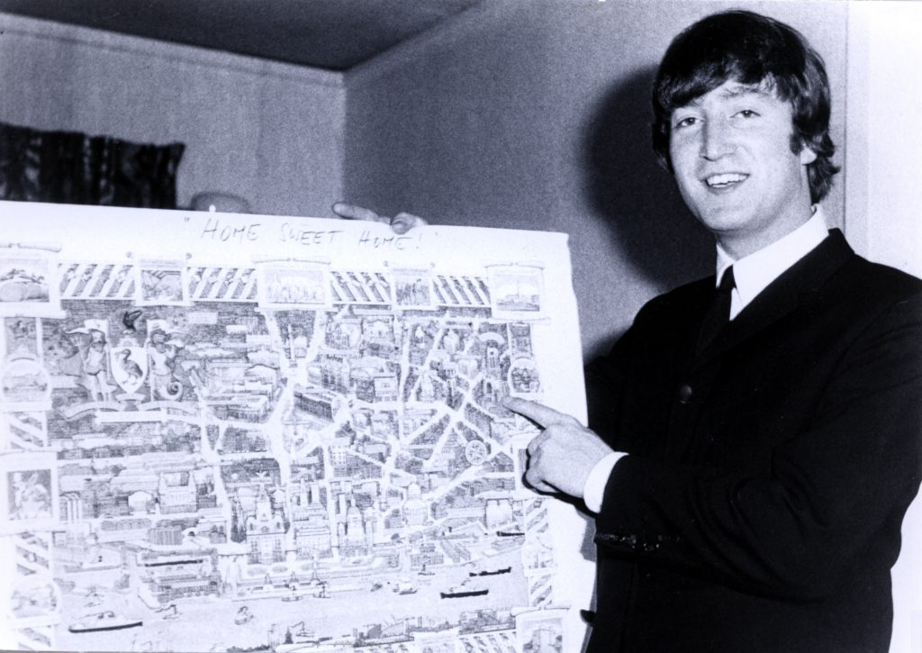 John Lennon with a map