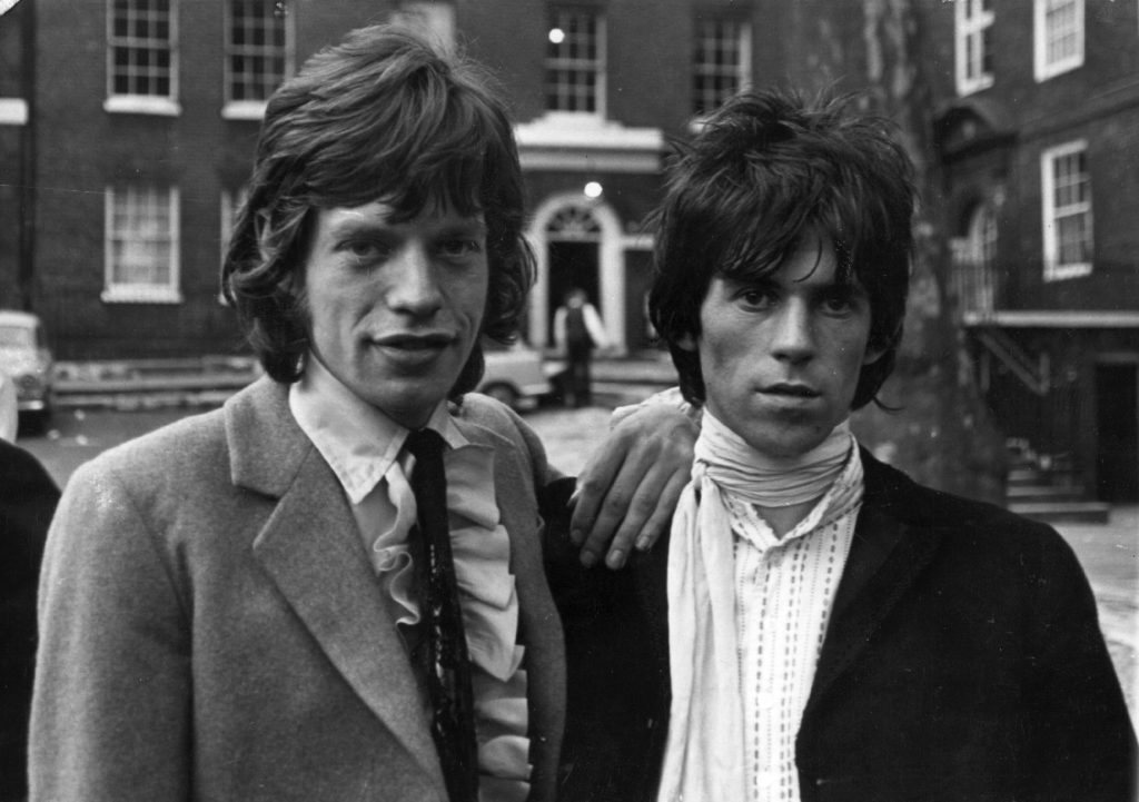 The Rolling Stones' Mick Jagger  and Keith Richards wearing suit jackets