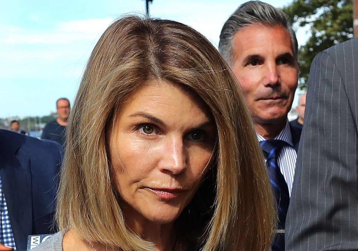 Lori Loughlin, with Mossimo Giannulli behind her