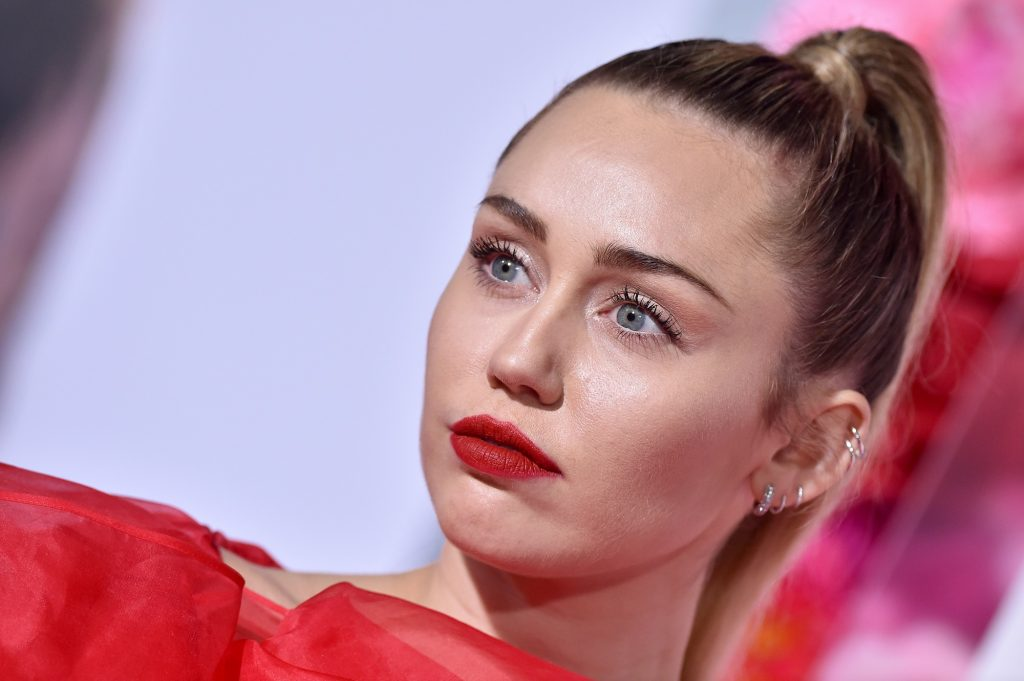 Miley Cyrus attends the premiere of Warner Bros. Pictures' 'Isn't It Romantic' at The Theatre at Ace Hotel on February 11, 2019 in Los Angeles, California.