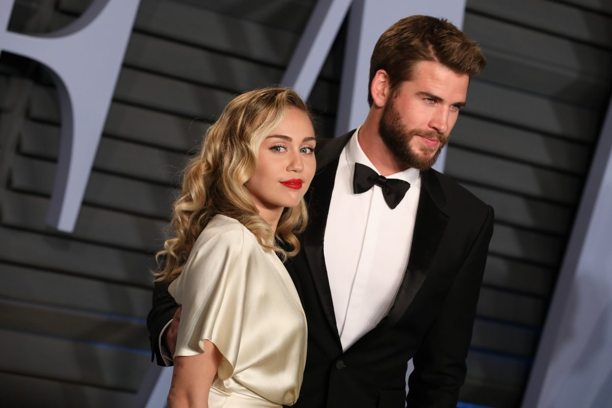 Miley Cyrus and Liam Hemsworth attend the 2018 Vanity Fair Oscar Party on March 04, 2018 in Beverly Hills, California.
