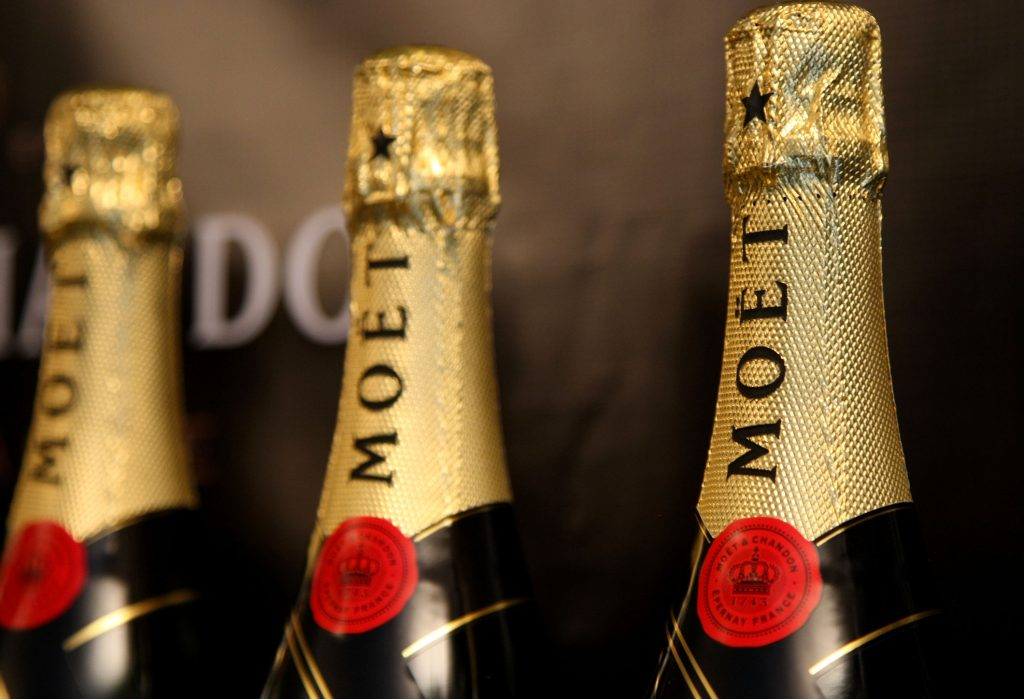 Three champagne bottles in a row
