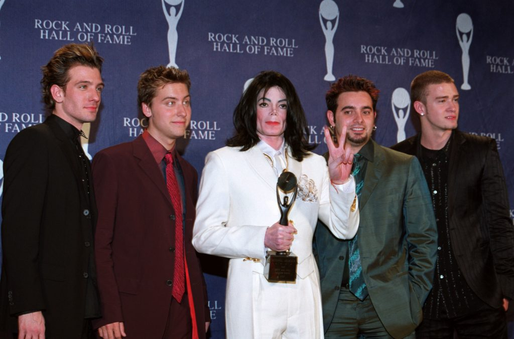 JC Chasez, Lance Bass, Michael Jackson, Chris Kirkpatrick, and Justin Timberlake wearing suits