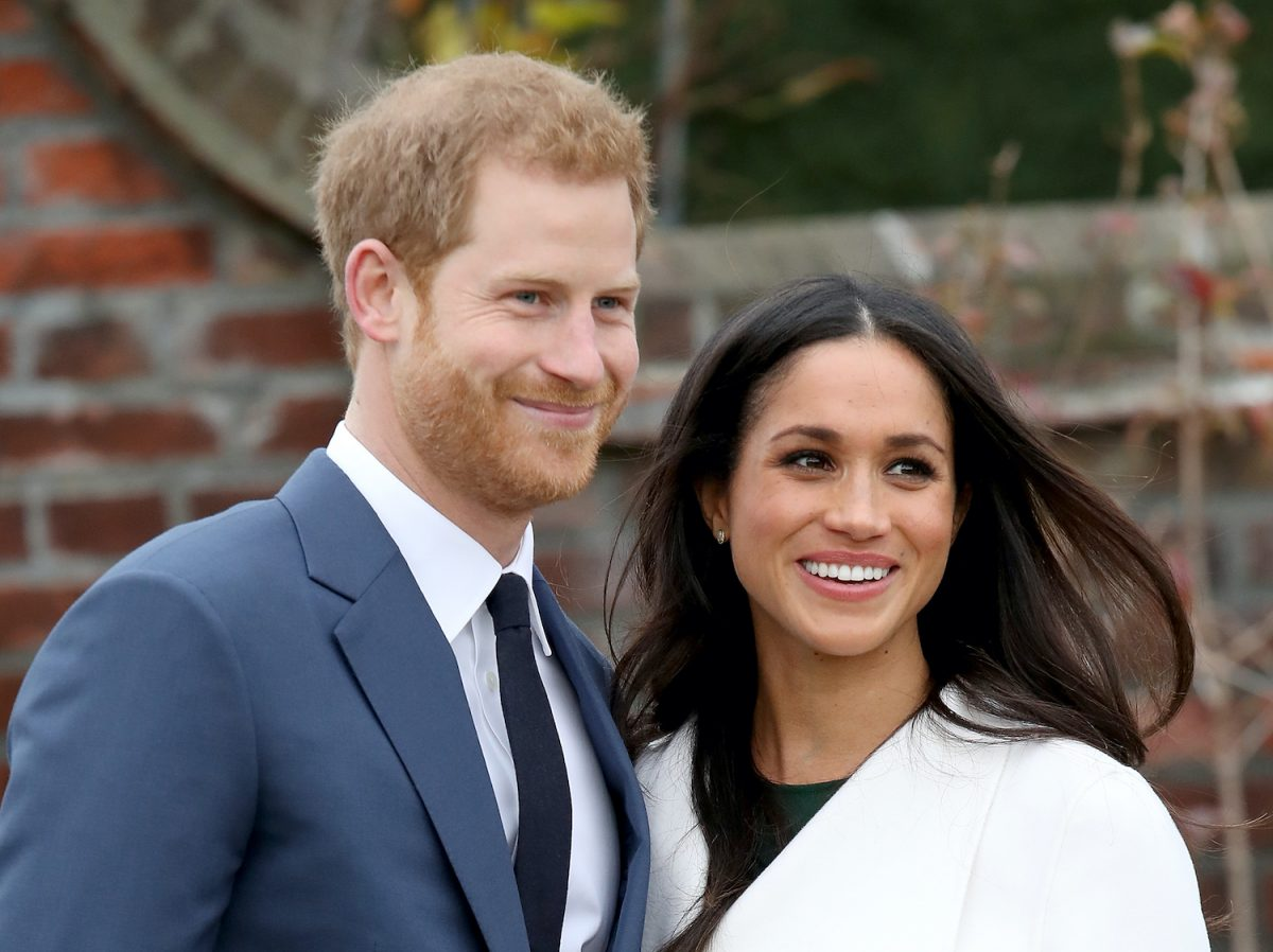 Prince Harry and Meghan Markle during an official photocall to announce their engagement at The Sunken Gardens at Kensington Palace