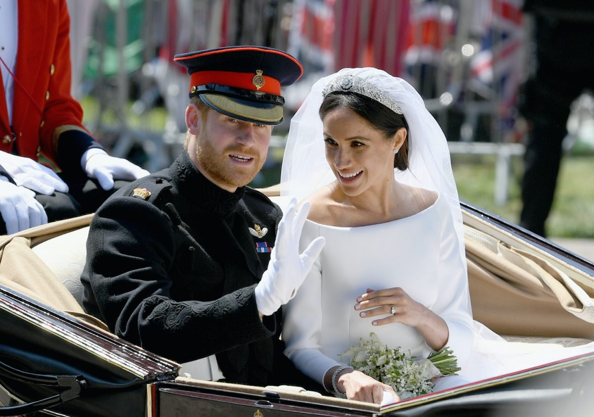 Prince Harry and Meghan Markle wave from the Ascot Landau Carriage during their carriage procession after their wedding ceremony