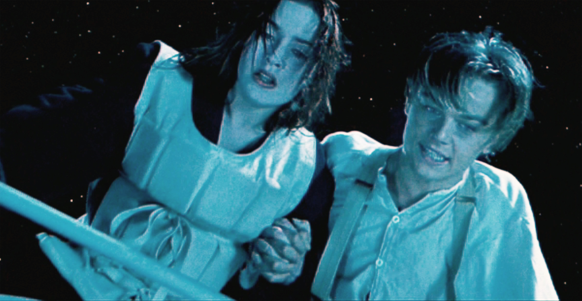 Rose (Kate Winslet) and Jack (Leonardo DiCaprio) on the Titanic, as the ship plunges into the water below.