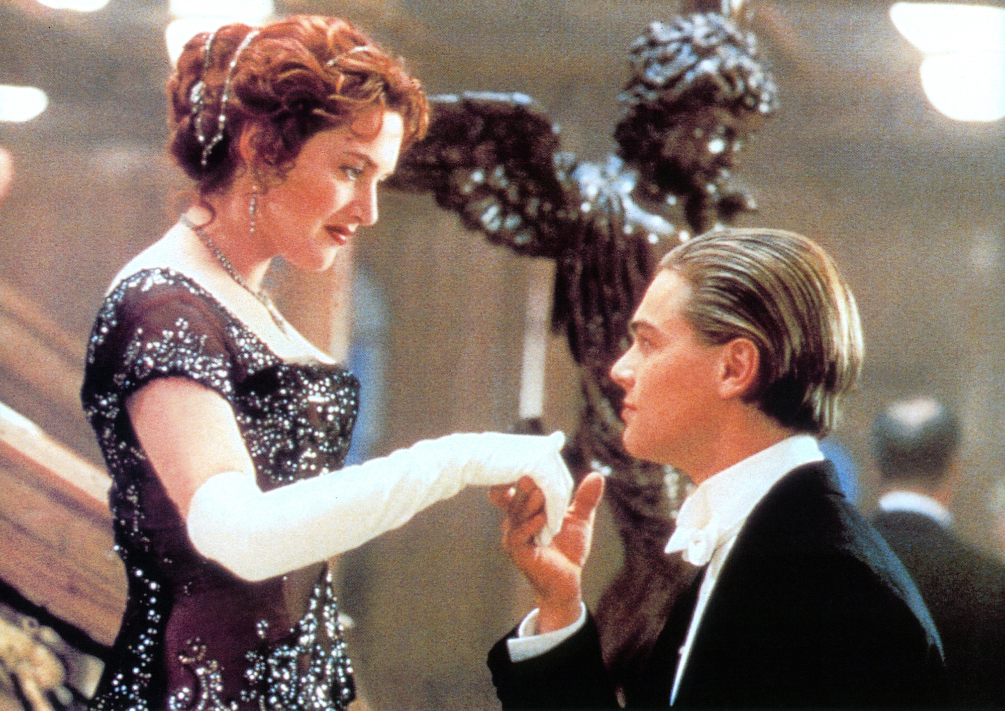 Kate Winslet offers her hand to Leonardo DiCaprio in a scene from the film 'Titanic', 1997.