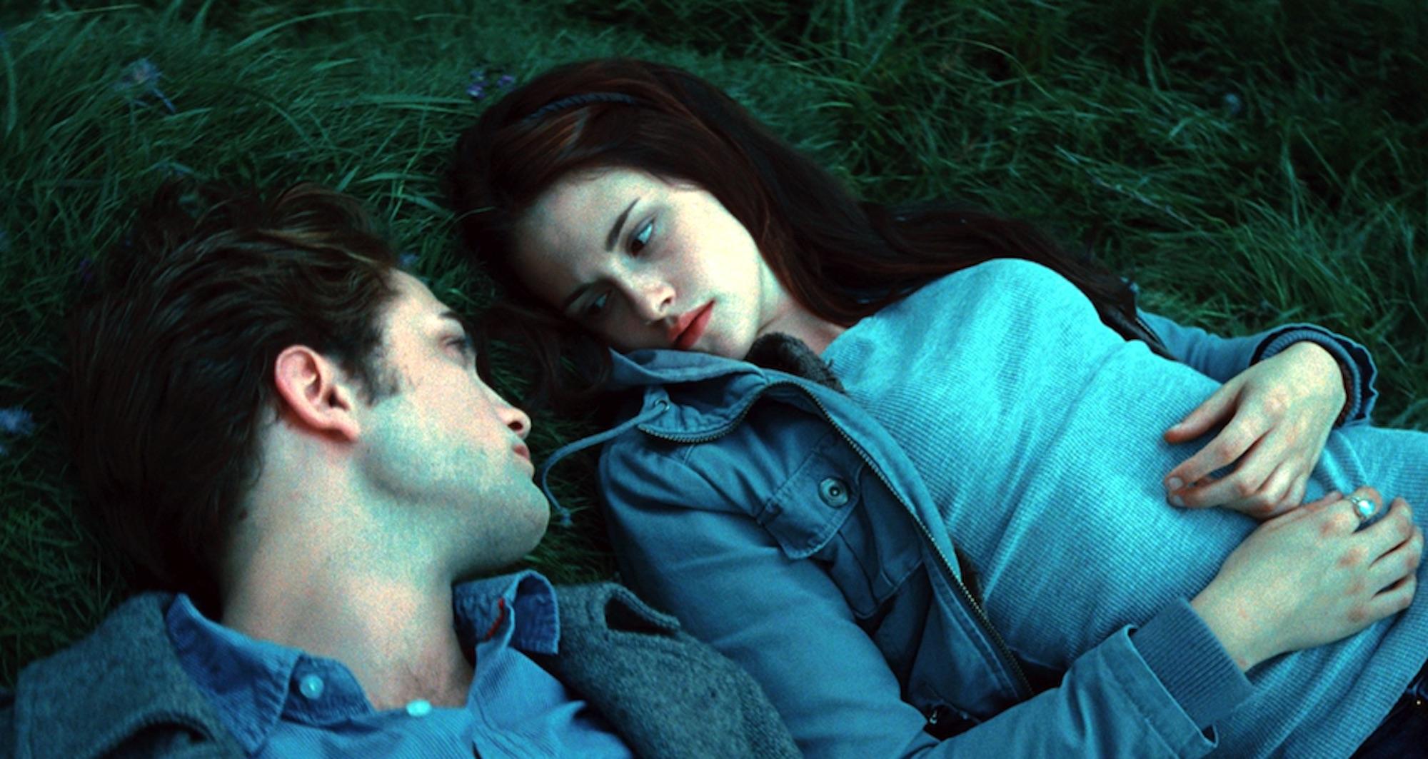 Edward Cullen (Robert Pattinson) and Bella Swan (Kristen Stewart) in his meadow in 'Twilight.'