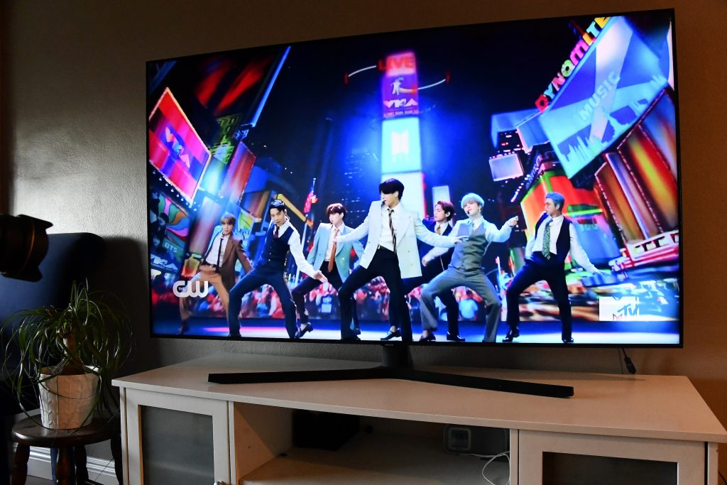 K-pop group, BTS, viewed on a television screen
