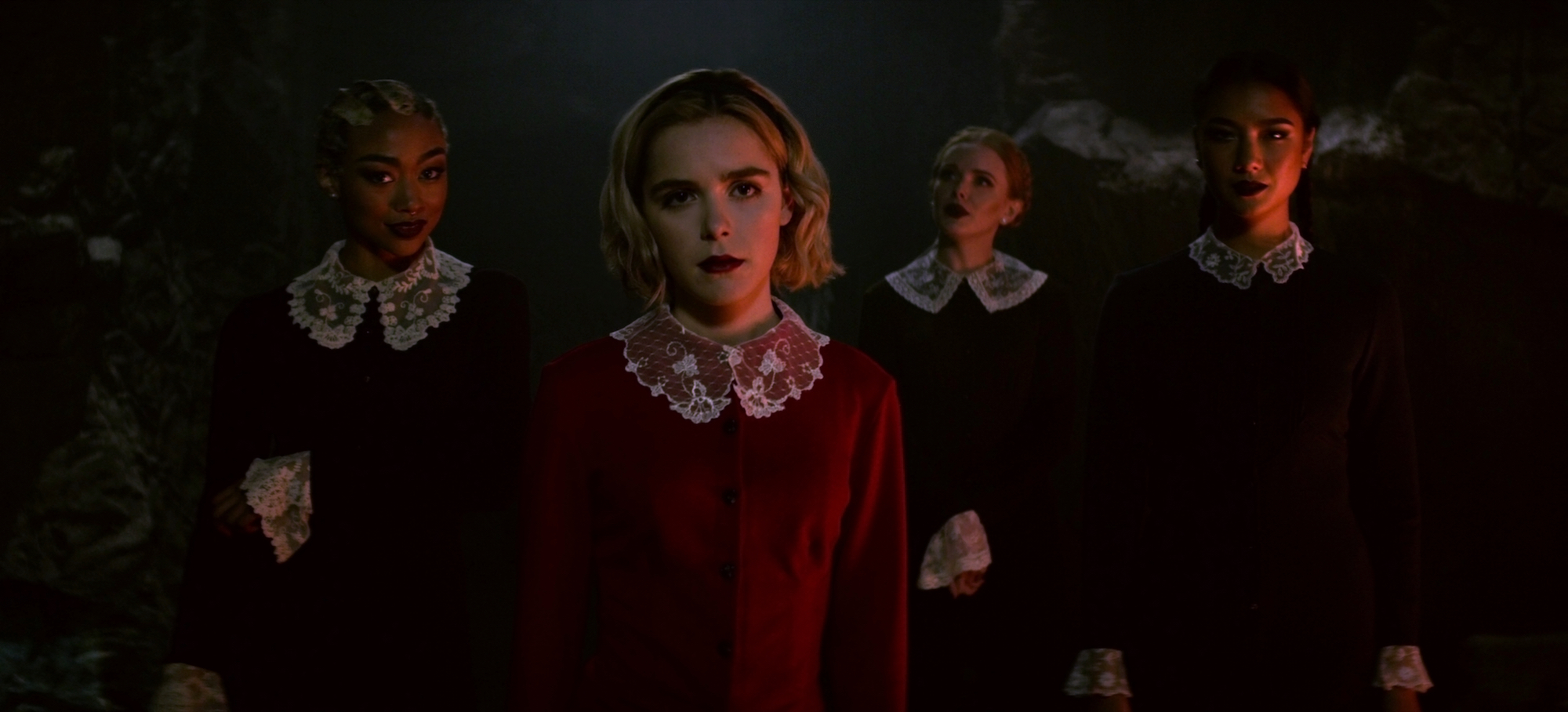 Tati Gabrielle, Kiernan Shipka, Abigail Cowen, and Adeline Rudolph in 'CHILLING ADVENTURES OF SABRINA,' Season 1.