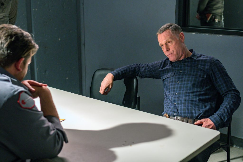 Jason Beghe as Hank Voight sitting in an interrogation room on 'Chicago P.D.'