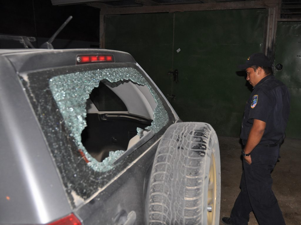 Costa Rican police officer inspects the damages caused by gunfire at Tom and Gisele's wedding