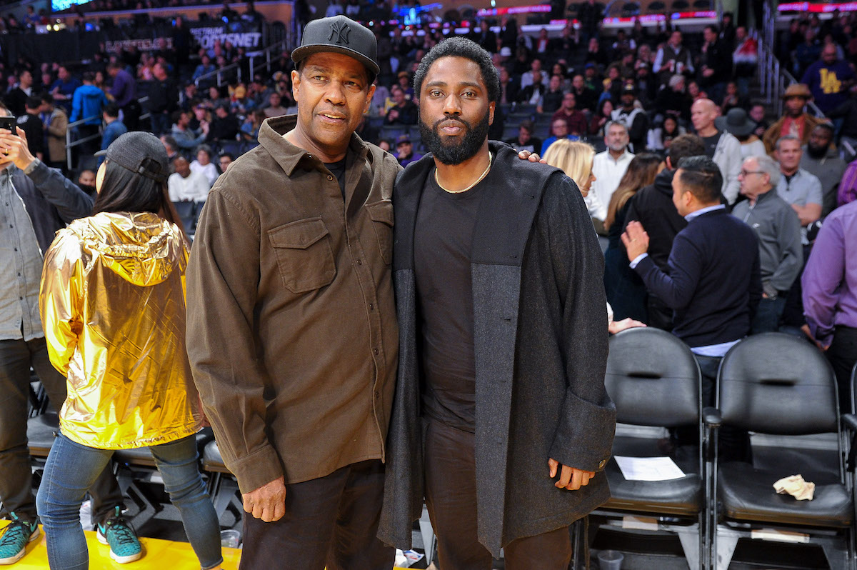 Denzel Washington and John David Washington attend a basketball game
