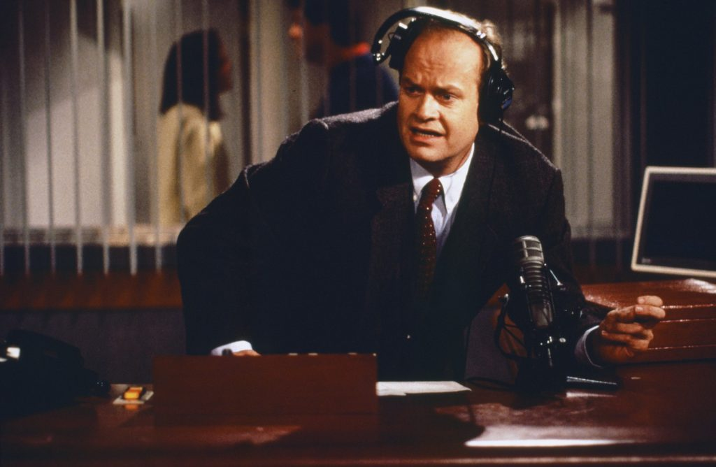 Kelsey Grammer as Doctor Frasier Crane in his radio studio