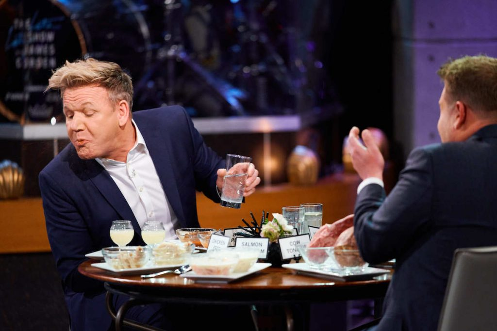 Gordon Ramsay spits food out in front of James Corden.