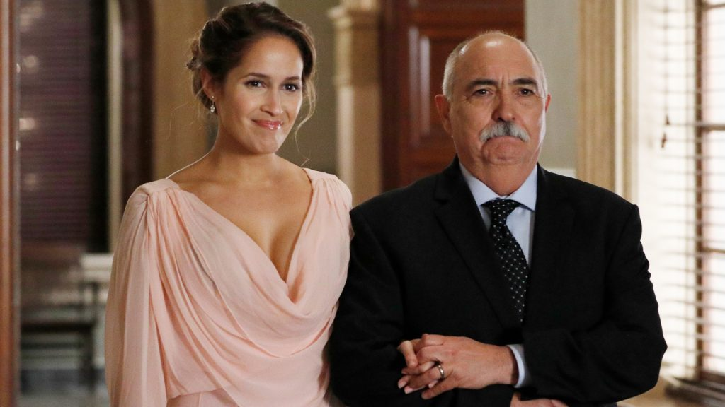 Jaina Lee Ortiz as Andy Herrera and Miguel Sandoval as Captain Pruitt Herrera on 'Station 19' Season 3 walking down the wedding aisle in the courthouse