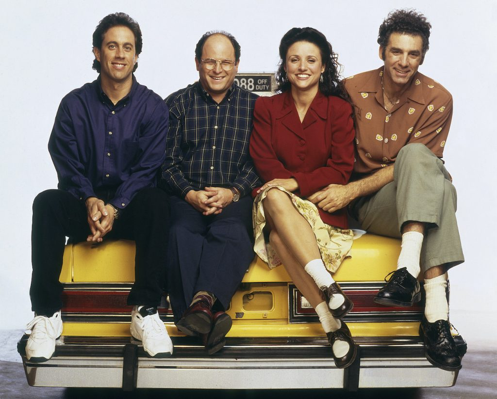 Jerry Seinfeld as Jerry Seinfeld,Jason Alexander as George Costanza, Julia Louis-Dreyfus as Elaine Benes, and Michael Richards as Cosmo Kramer on 'Seinfeld'