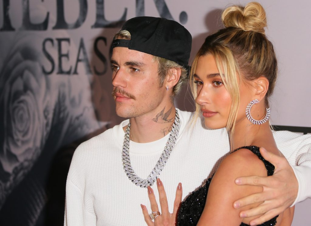 Justin Bieber and Hailey Bieber embraced facing the camera