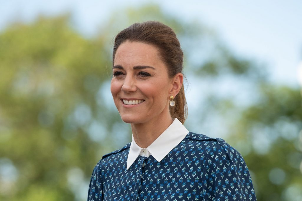 Kate Middleton smiling in front of a tree