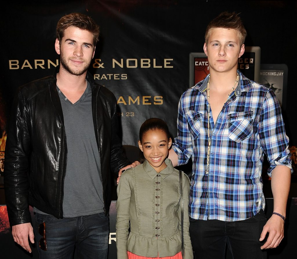 The Hunger Games cast members Liam Hemsworth, Amandla Stenberg, and Alexander Ludwig