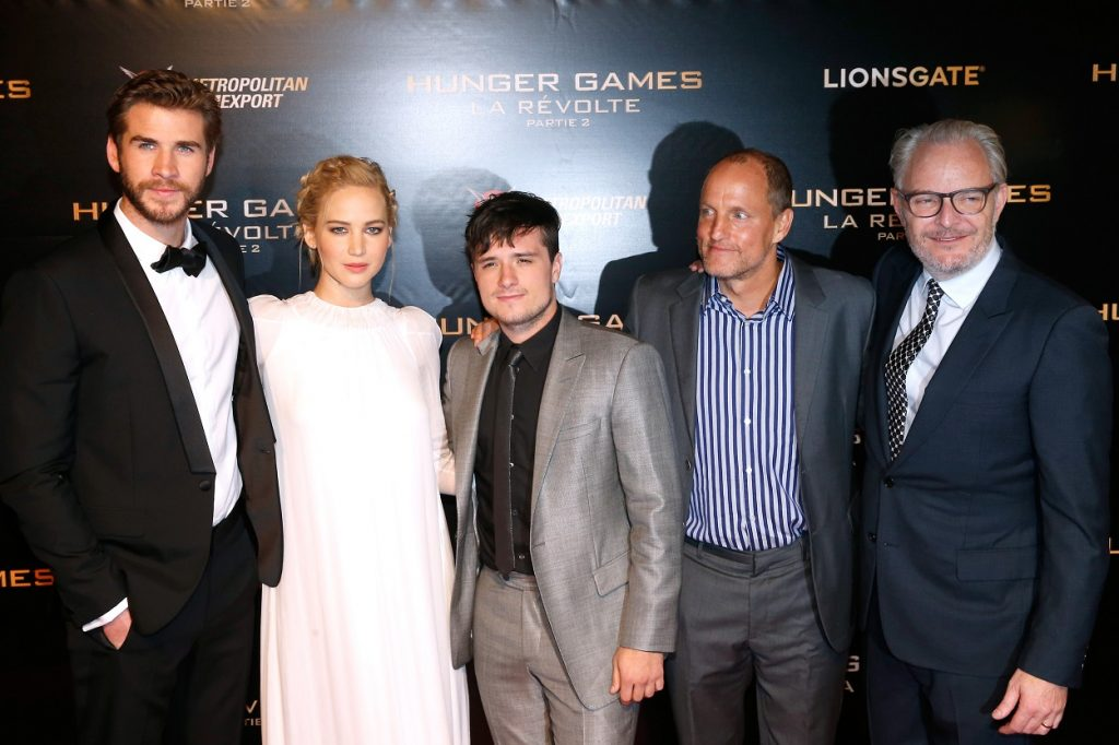 The Hunger Games cast Liam Hemsw.orth, Jennifer Lawrence, Josh Hutcherson, Woody Harrelson, and director Francis Lawrence
