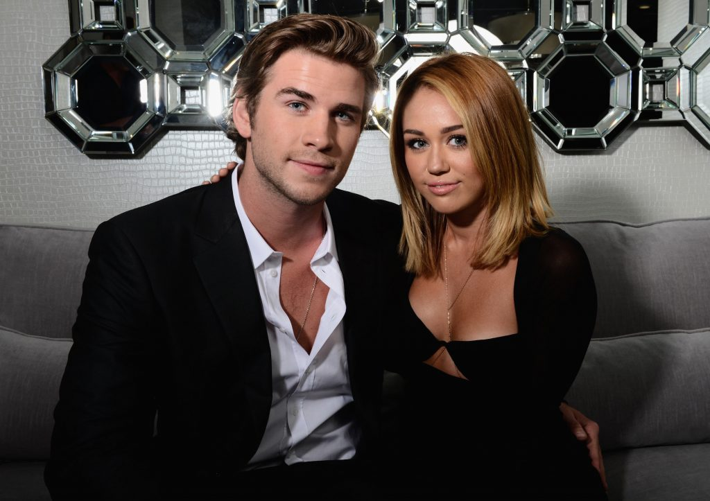 Actor Liam Hemsworth and singer Miley Cyrus pose during Australians In Film Awards & Benefit Dinner