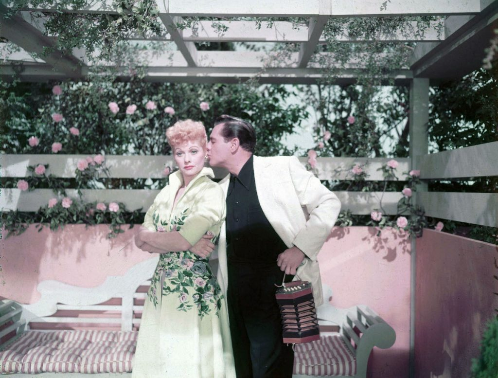 Lucille Ball getting kissed on the cheek by then-husband, Desi Arnaz