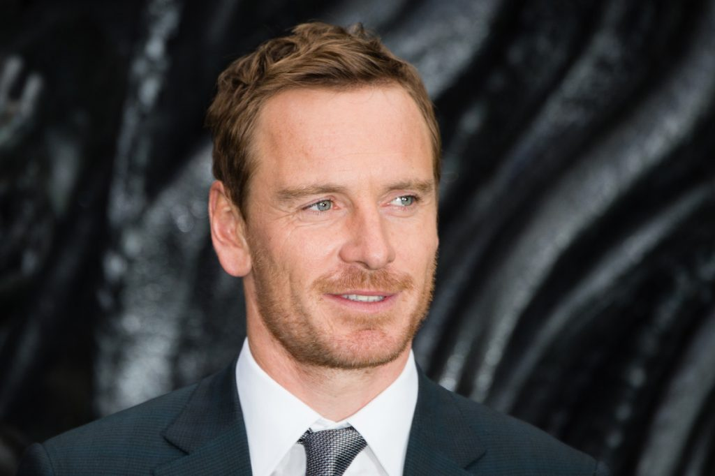 Michael Fassbender at a red carpet event.