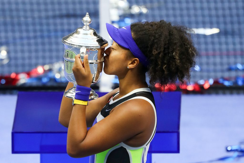 Naomi Osaka of Japan kisses the trophy in celebration after winning her Women's Singles final match against Victoria Azarenka of Belarus at the 2020 US Open