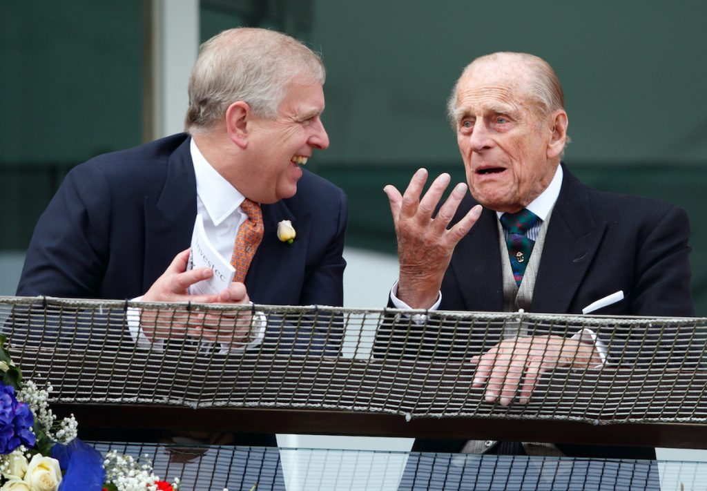 Prince Philip, Duke of Edinburgh and Prince Andrew, Duke of York watch the racing from the balcony of the Royal Box as they attend Derby Day during the Investec Derby Festival at Epsom Racecourse on June 4, 2016 in Epsom, England