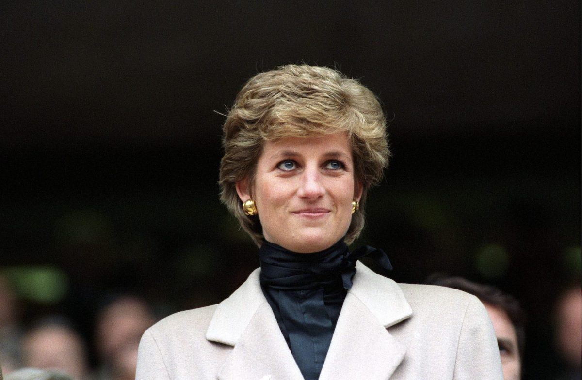 Princess Diana smiles at a rugby match