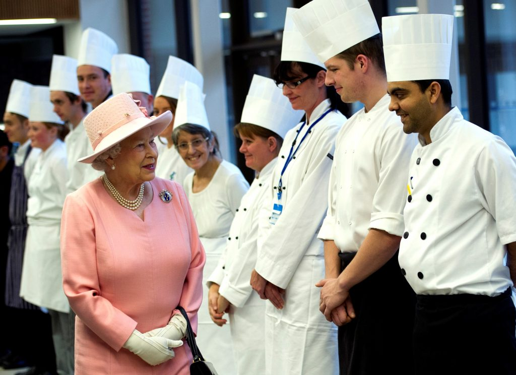 Queen Elizabeth II, Freeman of The Drapers' Company thanks the chefs for her school dinner as she officially opened The Drapers' Academy