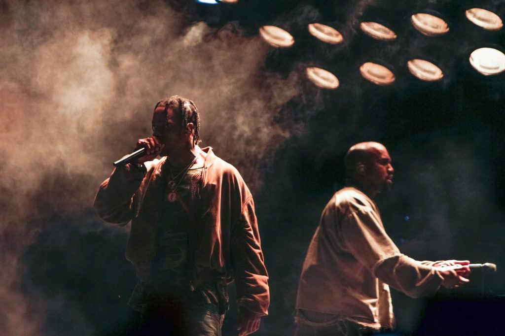 Travis Scott and Kanye West performing on stage