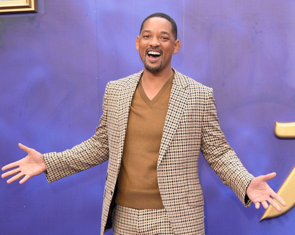 Will Smith smiling with his arms out