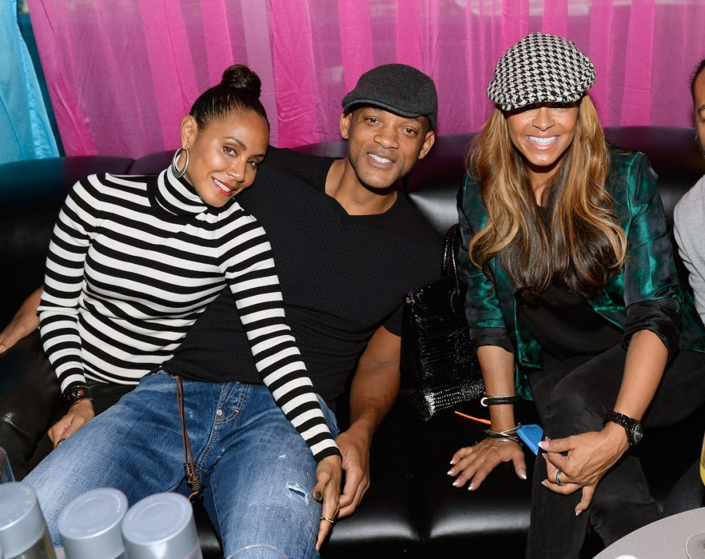 Will Smith sits in between his wife, Jada Pinkett Smith (left), and his ex-wife, Sheree Zampino, in 2014.