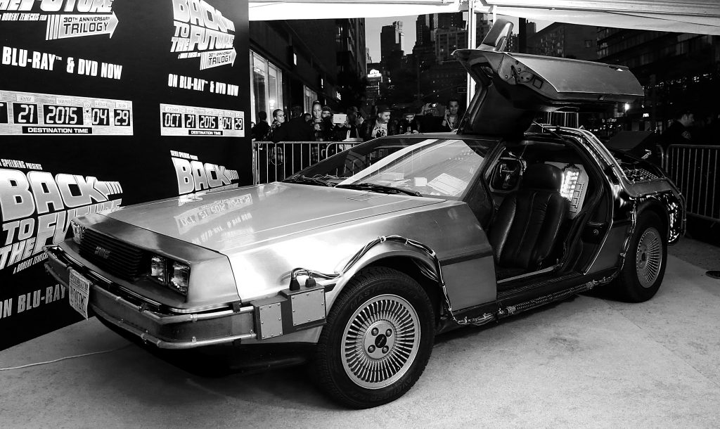 A DeLorean near the Back to the Future logo