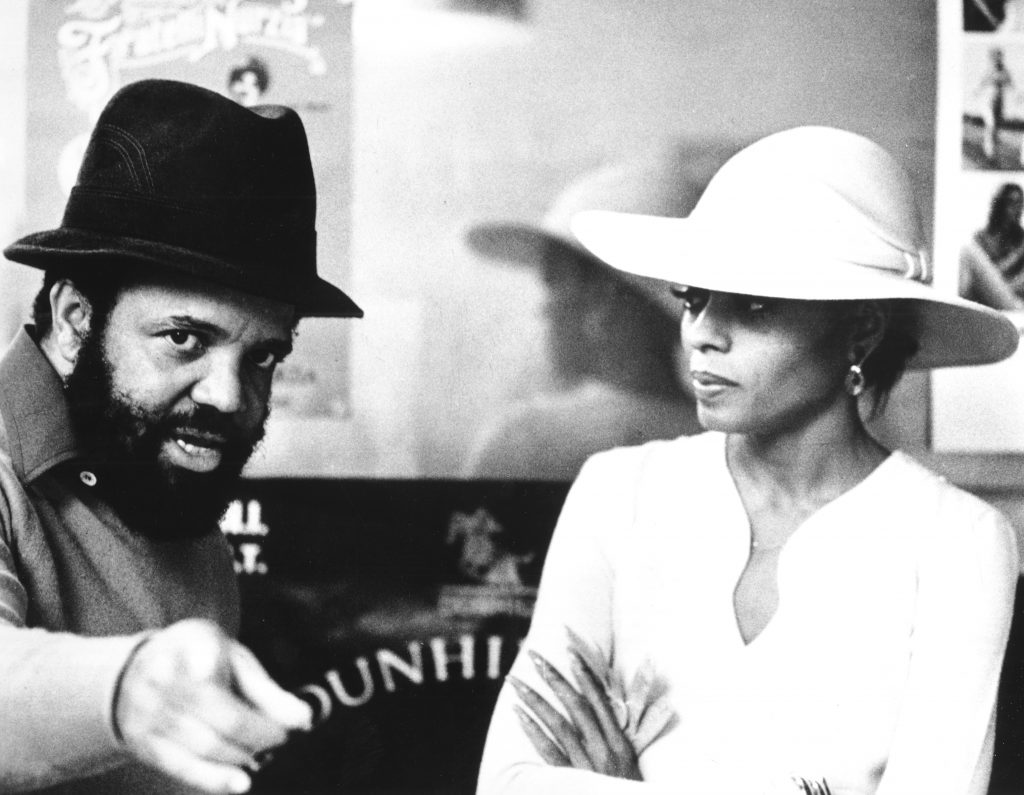 Berry Gordy and Dian Ross wearing hats