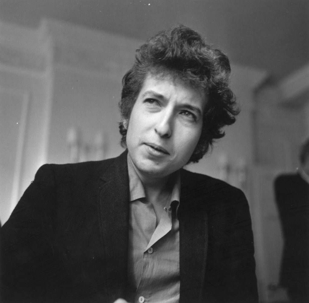 Bob Dylan in front of a wall