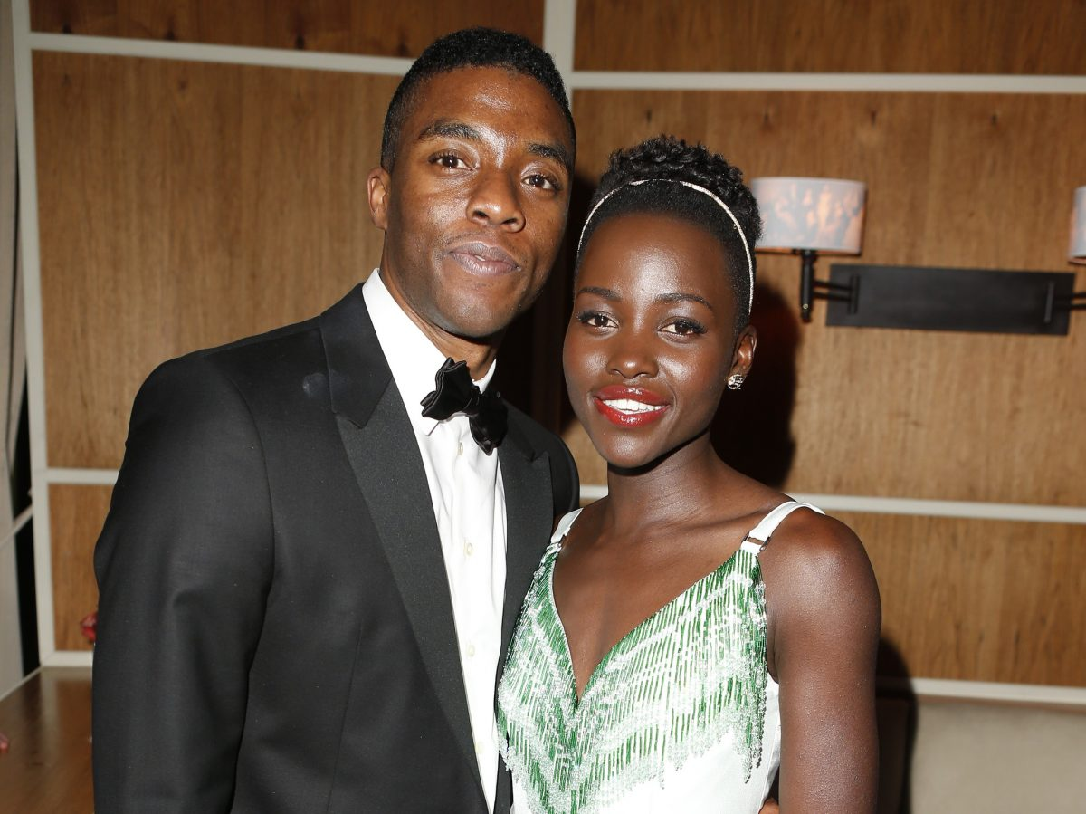 Chadwick Boseman and Lupita Nyong'o attend the 2014 Vanity Fair Oscar Party Hosted on March 2, 2014 in West Hollywood, California.