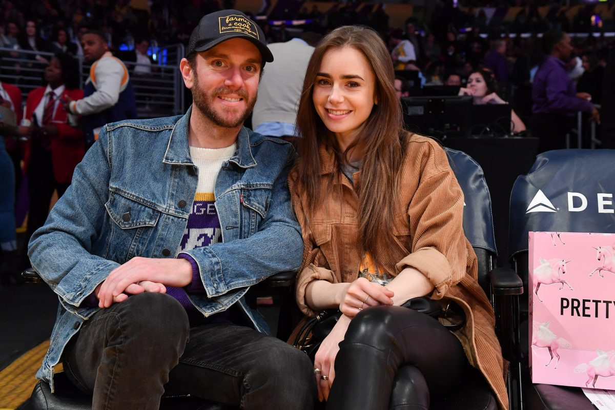 Lily Collins and Charlie McDowell attend a basketball game between the Los Angeles Lakers and the Cleveland Cavaliers on January 13, 2020