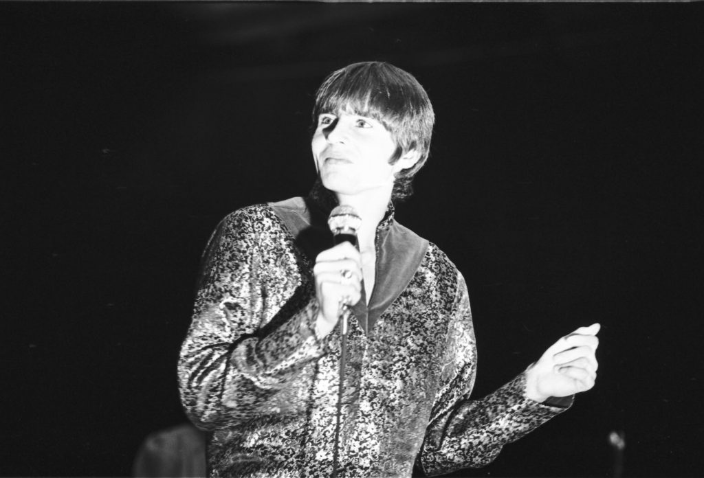 Davy Jones with a microphone