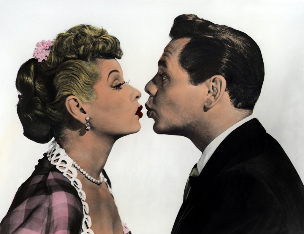Lucille Ball about to kiss Desi Arnaz