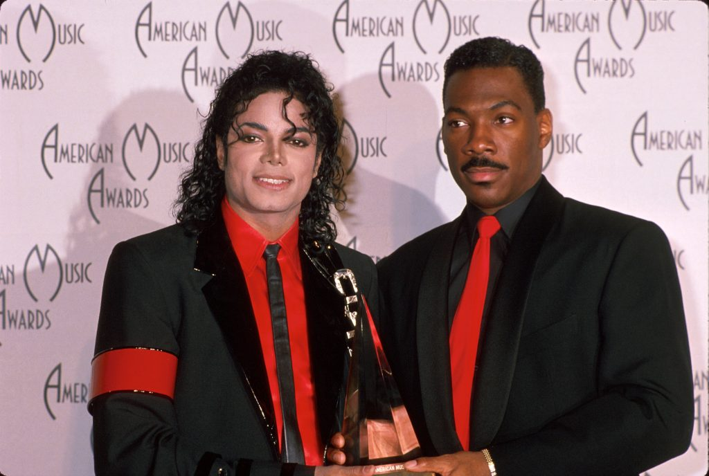 Michael Jackson and Eddie Murphy with an award