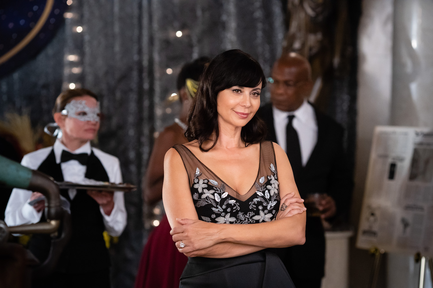 Catherine Bell as Cassie stands with crossed arms in an episode of Good Witch