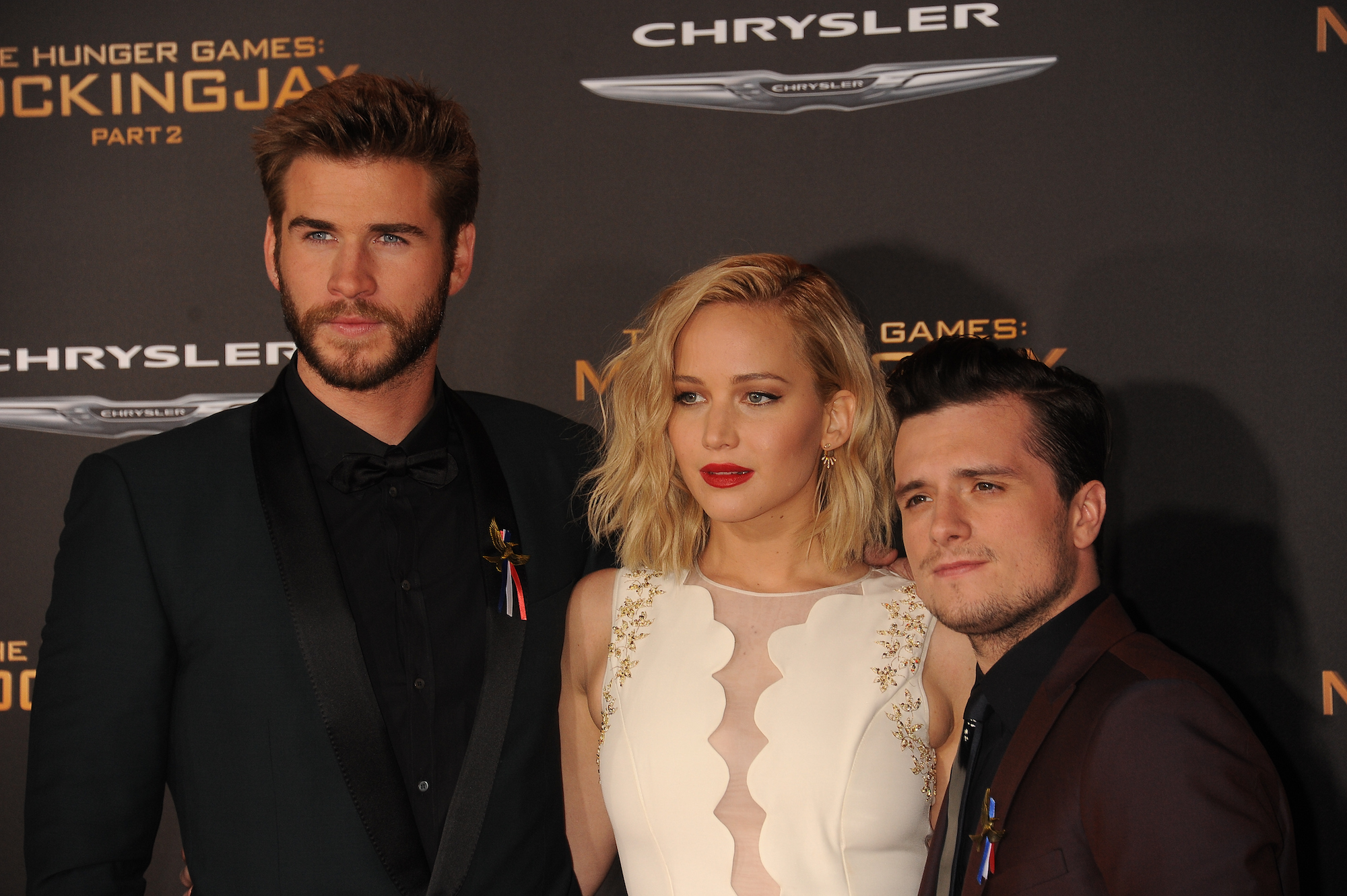 Liam Hemsworth, Jennifer Lawrence, and Josh Hutcherson at the premiere of 'The Hunger Games: Mockingjay - Part 2' at the Microsoft Theater.